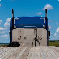 flat-bed-blue-truck-rear